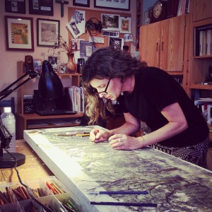Judith Monroe working in her art studio 2013